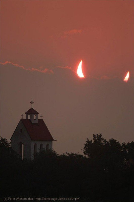 partial solar eclipse devil horns sun